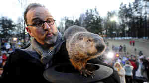 Groundhog handler Ben Hughes and Punxsutawney Phil earlier this morning.