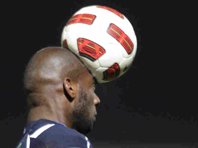 Not only football players are at risk for head injuries — soccer, basketball and volleyball players can sustain concussions, too. Michael Ciani, a defender for the French soccer team Bordeaux, heads the ball during a French Cup match on Jan. 22.
