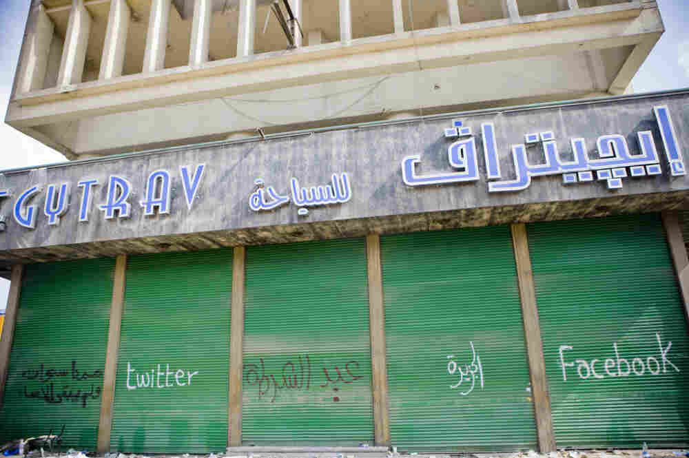 Blogger Hossam el-Hamalawy says this graffiti on a building near Tharir Square shows how the revolution has been reported: Twitter, Al-Jazeera, Facebook.
