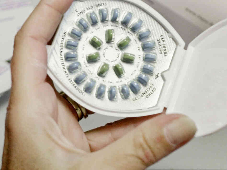 A registered nurse holds a birth control pill pack at a Planned Parenthood clinic in Shrewsbur