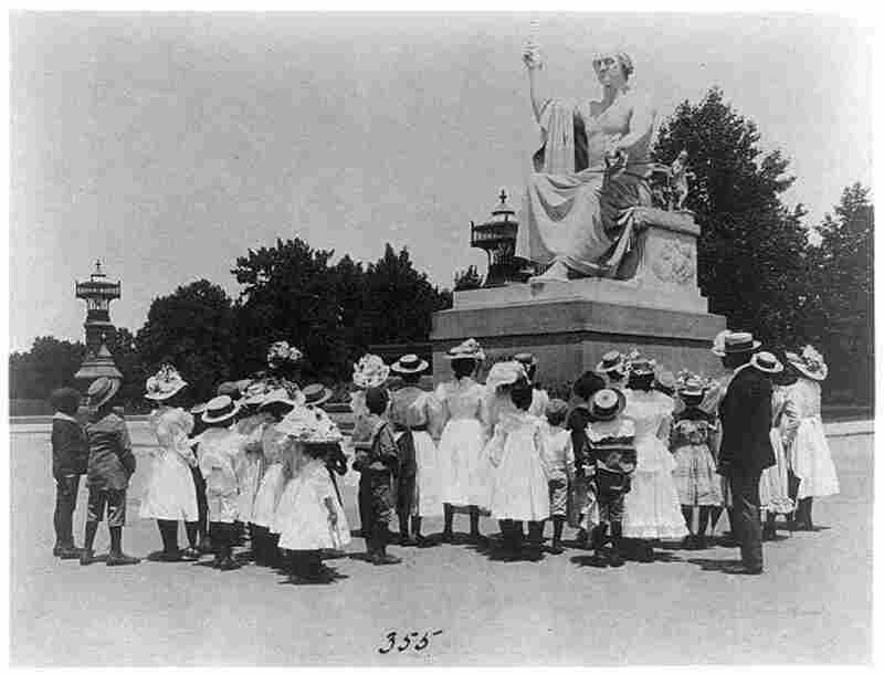 African American school children facing the Horatio Greenough statue of George Washington at the U.S. Capitol, circa 1899. Washington owned slaves, and his presidency ended before construction on the White House could finish. Photograph by Frances Benjamin Johnston.