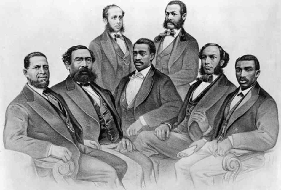 The first black senator and representatives, from the 41st and 42nd Congress of the United States. (Left to right) Senator Hiram Revels of Mississippi, Representatives Benjamin Turner of Alabama, Robert DeLarge of South Carolina, Josiah Walls of Florida, Jefferson Long of Georgia, Joseph Rainey and Robert B. Elliot of South Carolina. By Currier and Ives, 1872