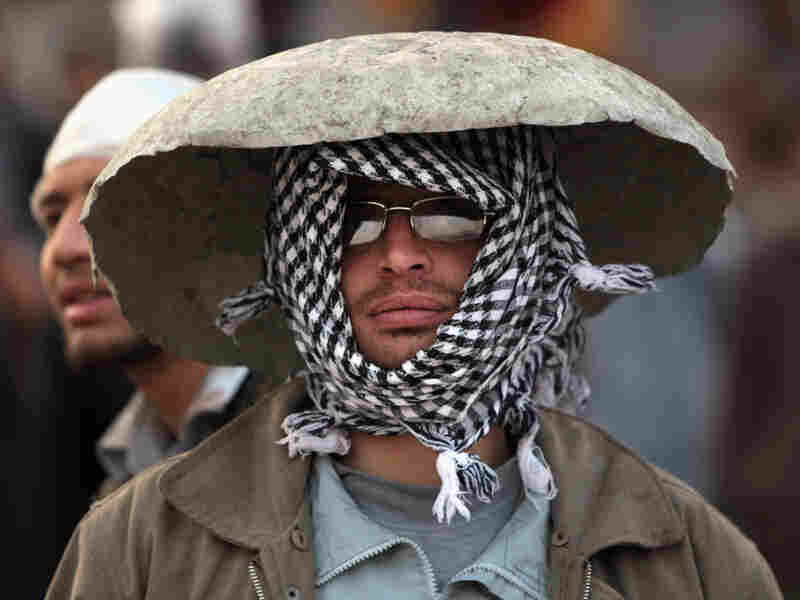 An anti-government protester in a makeshift helmet earlier today (Feb. 3, 2011) in Cairo.