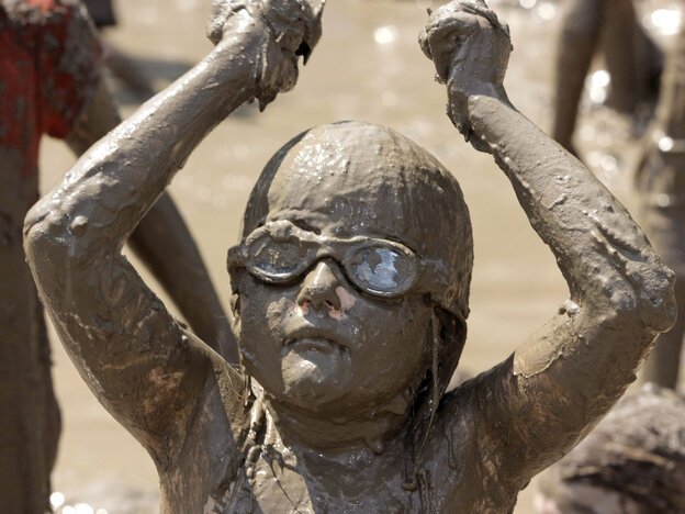 Not all young girls avoid dirt. Hannah Rose Akerley, 7, plays in a gigantic lake of mud at the annual Mud Day event in Westland, Mich., last July.