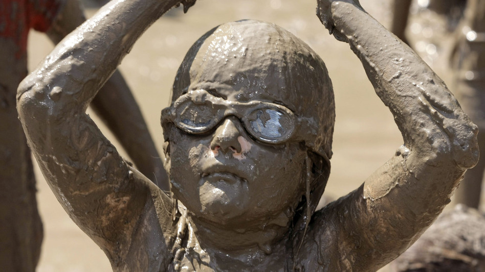 Not all young girls avoid dirt. Hannah Rose Akerley, 7, plays in a gigantic lake of mud at the annual Mud Day event in Westland, Mich., last July. (Getty Images)
