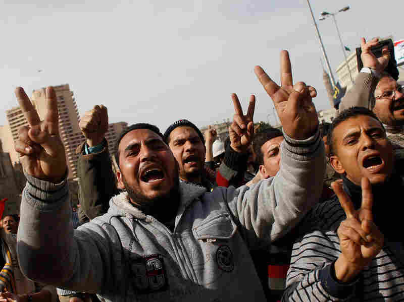 Egyptian men protest against the government of Egyptian president Hosni Mubarek during a march in central Tahrir Square Cairo. Many compare the unfolding situation to Iran circa 1979.