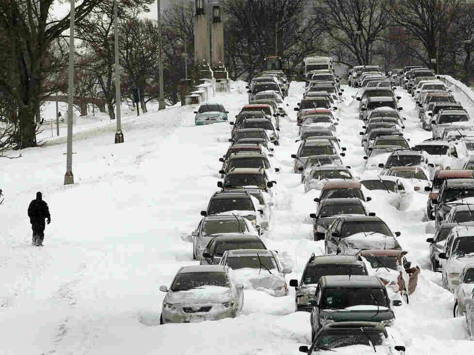 Cars sit in the northbound lanes of Lake Shore Drive after accidents and  drifting snow stranded the drivers during last night's blizzard February 2, 2011  in Chicago, Illinois.