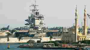 The USS  Enterprise passes behind a mosque as it makes its way through the Suez Canal in the city of Suez, Egypt,  on Aug. 1, 2007.