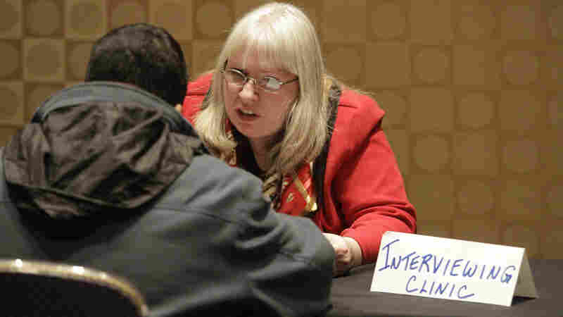 Kelly Rice, an independent human resources counselor, volunteers as an interview techniques trainer during a job fair in Boston.