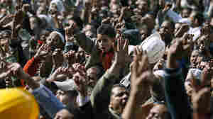 Anti-government protesters react in Cairo's Tahrir Square on Friday.