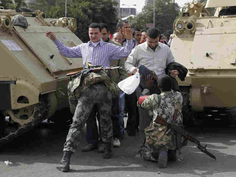 Soldiers search anti-government protesters heading to Friday rallies in Tahrir Square in downtown Cairo.