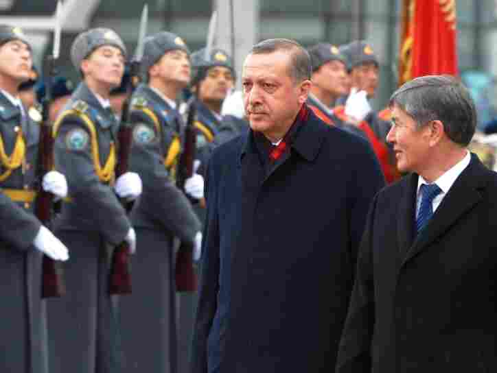 Turkish Prime Minister Recep Tayyip Erdogan (center) reviews an honor guard with Kyrgyzstan's Prime Minister Almazbek Atambayev during an official welcome ceremony for Erdogan in the Kyrgyz capital Bishkek on Feb. 2.
