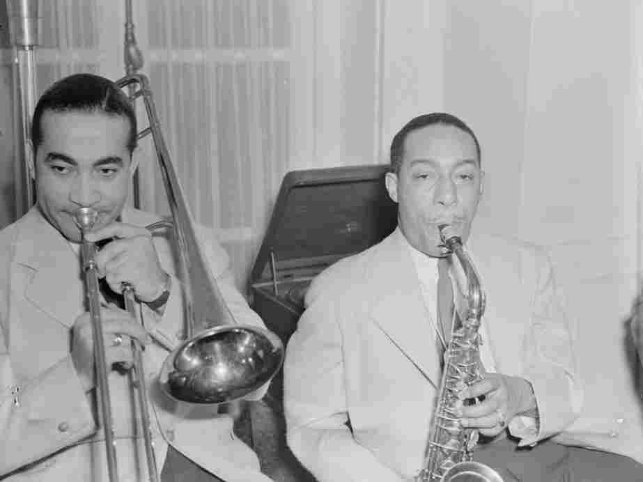 Trombonist Lawrence Brown and alto saxophonist Johnny Hodges, both of the Duke Ellington Orchestra, pictured at a jam session at the Turkish ambassador's residence.
