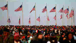 WASHINGTON, D.C. - JANUARY 20:   People gather for the inauguration of Barack Obama as the 44th President of the United States of America on the National Mall January 20, 2009 in Washington, DC. Obama becomes the first African-American to be elected to the office of President in the history of the United States.  (Photo by Mario Tama/Getty Images)