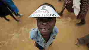 A villagers of Nyang'oma wears a paper hat with a message reading 'We have Hope' ahead of the inauguration of US President-elect Barack Obama on January 20, 2009 in Kogelo. More than 2,000 Kenyans and tourists united in song and dance to celebrate Barack Obama's inauguration in Kogelo, the Kenyan village where the new US president's father was born. AFP PHOTO/ Tony KARUMBA