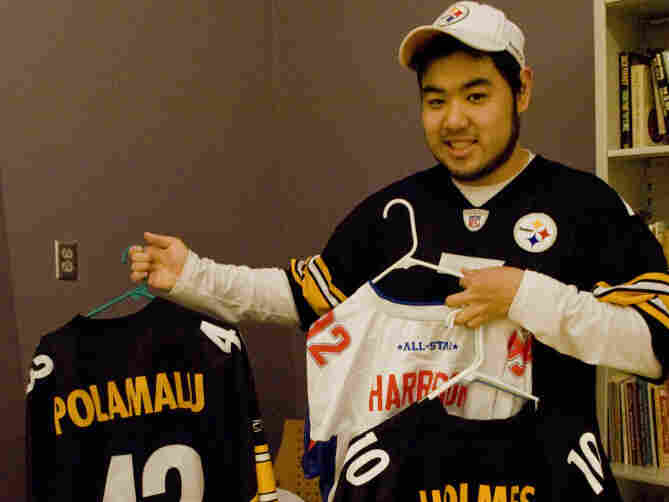 Tony Song, 22, shows off his authentic Pittsburgh Steelers gear. He's bought more than 25 jerseys from official NFL retailers and claims he can spot a counterfeit.