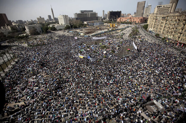 Egyptian anti-government protesters pray at Tahrir Square in Cairo on Friday.