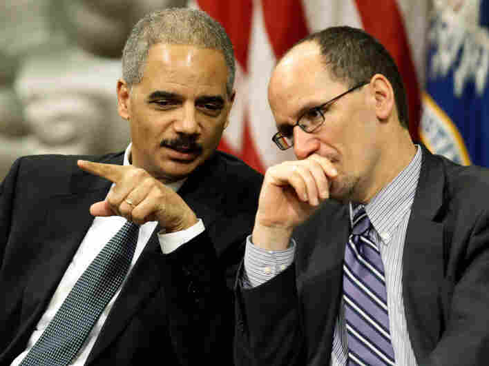 U.S. Attorney General Eric Holder (left) talks with Assistant Attorney General for Civil Rights Tom Perez during the Dr. Martin Luther King Jr. Commemorative Program at the Department of Justice on Jan. 11. The department is putting a focus on civil rights, including developing special units.
