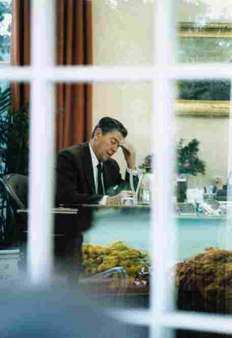 President Reagan, seen in the Oval Office, drafts a speech to the nation about the U.S. invasion of Grenada and the aftermath of the Marines killed in Lebanon, October 1983.