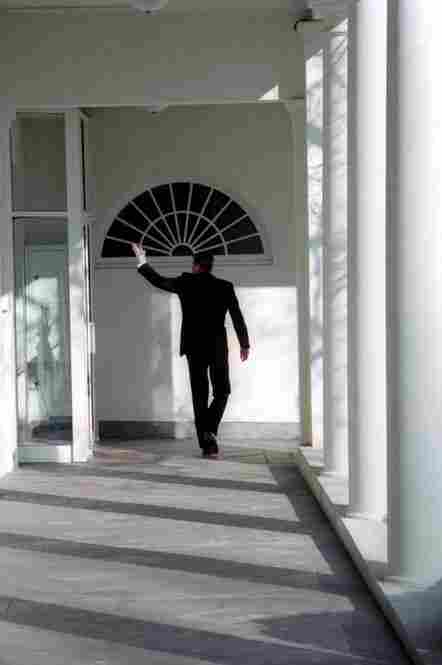 Reagan walks along the White House colonnade and waves goodbye on his last day in office, Jan. 20, 1989. He left office with an approval rating of more than 60 percent.