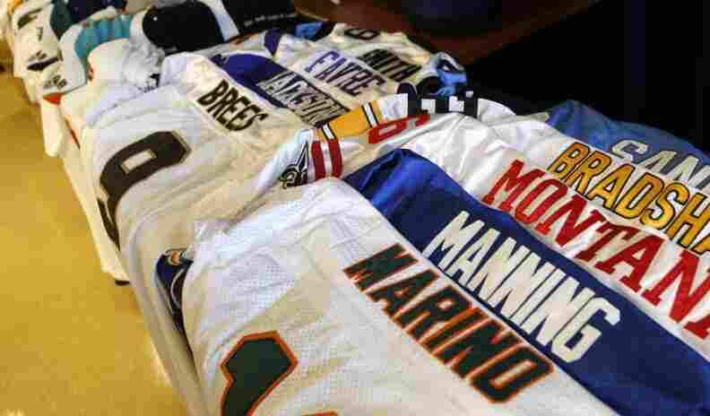Confiscated counterfeit NFL jerseys, caps and T-shirts found during an Immigration and Customs Enforcement raid in Miami leading up to last year's Super Bowl.