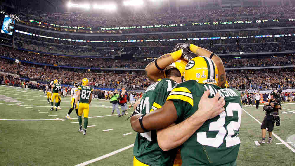 Aaron Rodgers #12 and Brandon Jackson #32 of the Green Bay Packers celebrate after winning Super Bowl XLV against the Pittsburgh Steelers.