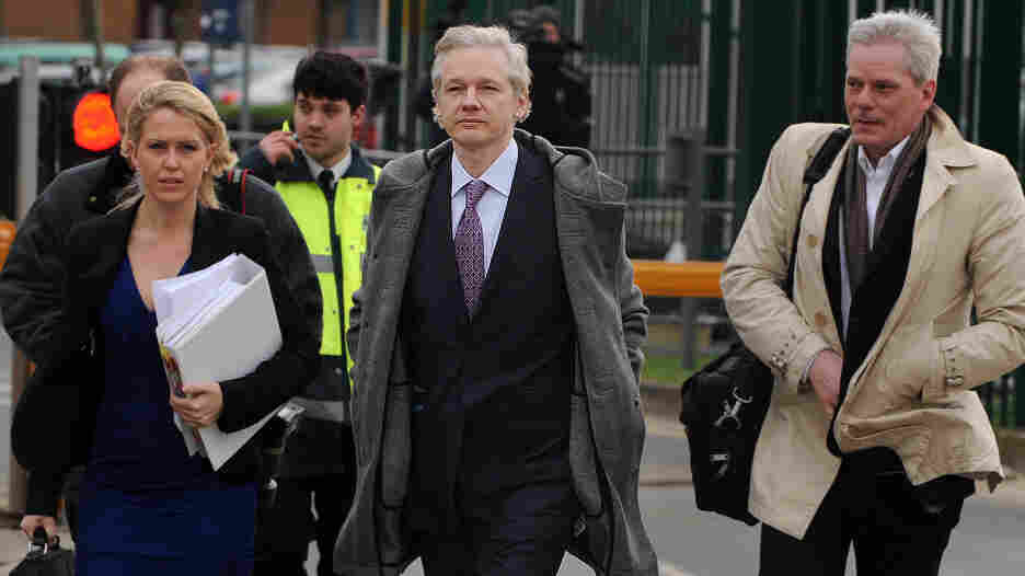 WikiLeaks founder Julian Assange (center) and lawyer Jennifer Robinson arrive Monday at Belmarsh Magistrates' Court in London on Monday.