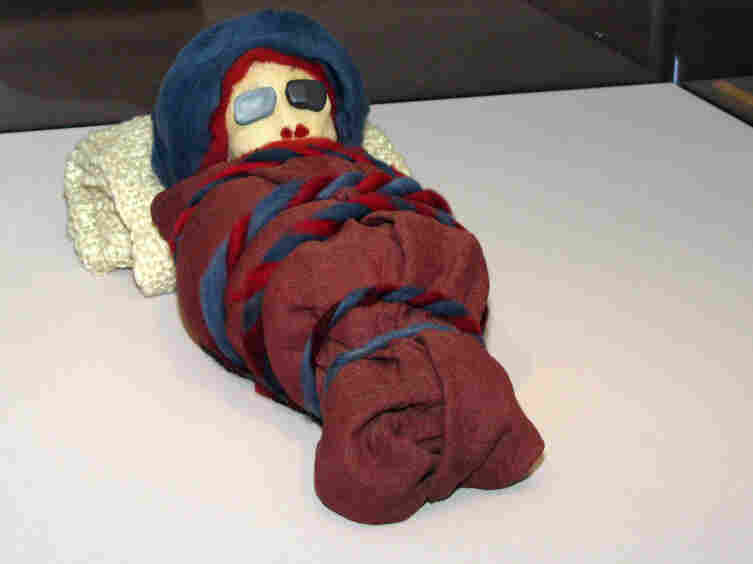 The stand-in mummies, including this infant mummy, were deployed in a last-minute rush by exhibit designer Kate Quinn and her staff.