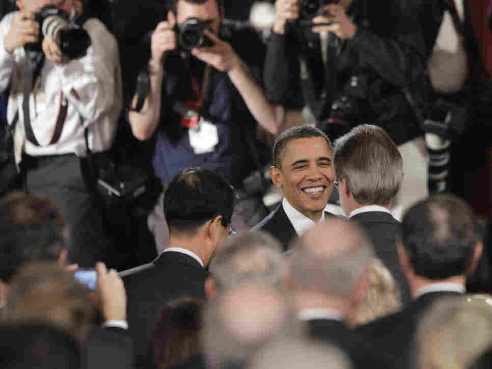 President Obama greets the U.S. Chamber of Commerce audience members after his speech.