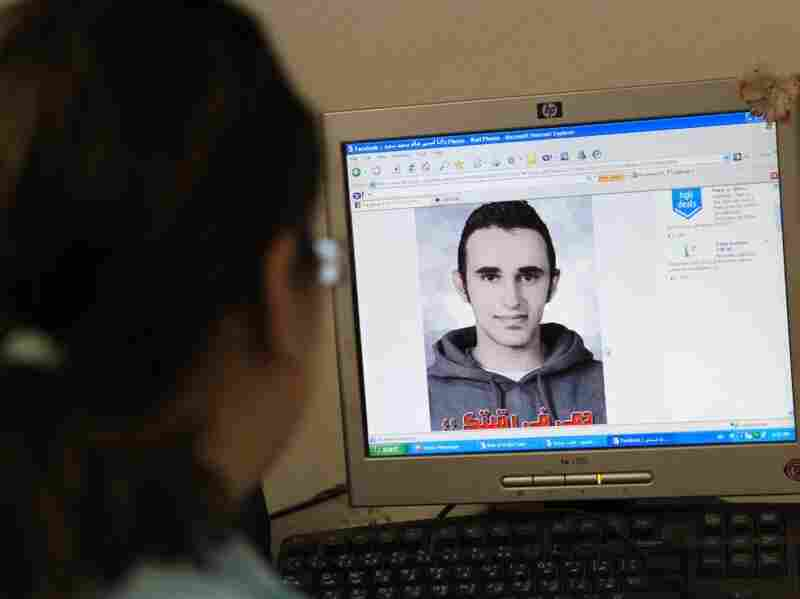 An Egyptian woman in Cairo in June previews a Facebook Web page showing a picture of Khaled Said, an Egyptian allegedly tortured to death by police in Alexandria.