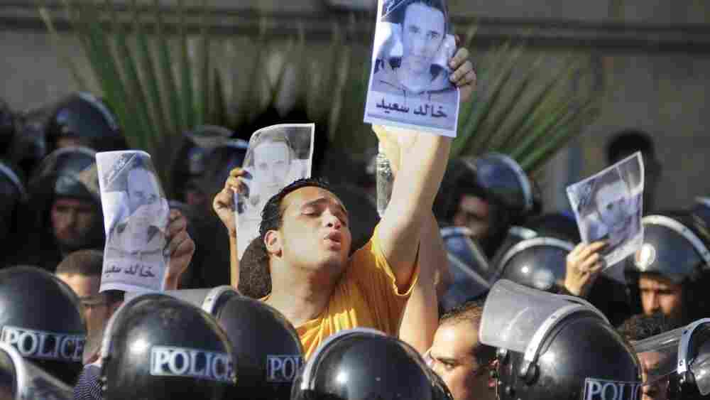 Egyptians shout anti-police slogans and hold up posters of 28-year-old  Khaled Said during a demonstration in Alexandria, Egypt, Sept.  25, 2010.
