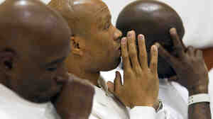 Johnny Mack Young, Lawrence Parker and Frederick Jackson attend graduation ceremonies at William  E. Donaldson prison in Bessemer, Ala., after  completing Vipassana meditation classes. The courses are held four times a year  in the prison gymnasium.