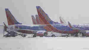 Southwest Airlines planes sit idle at Love Field in Dallas as snow falls on Feb. 4. Analysts say this winter's storms may have already cost airlines more than $6oo million.