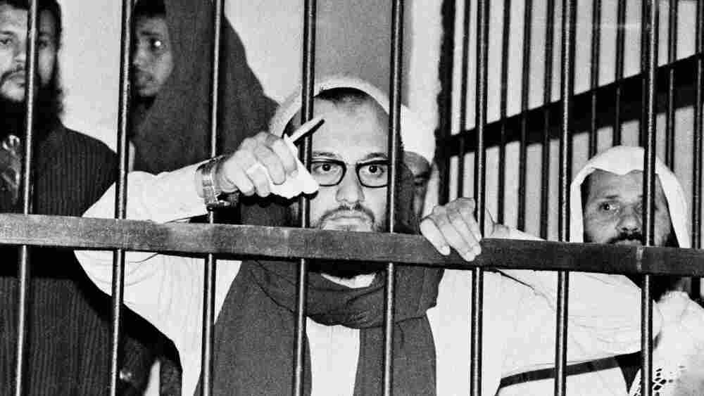 Ayman al-Zawahiri stands behind bars in an  Egyptian court in 1982 during his trial as one of the alleged masterminds of the assassination of Egyptian President Anwar Sadat.