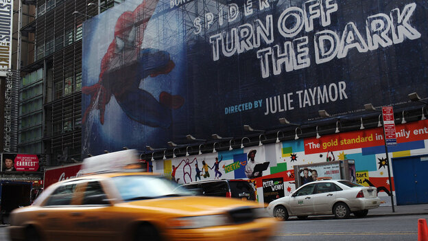 A sign for the Broadway play Spider-Man: Turn off the Dark is seen along 42nd Street in New York City.
