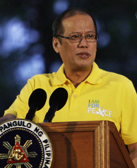 President Benigno Aquino III speaks during a peace rally Tuesday in suburban Quezon City north of Manila, Philippines. Aquino, who promised to root out widespread corruption when he was elected last year, has an approval rating of 80 percent.
