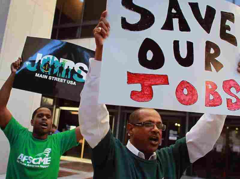 American Federation of State County and Municipal Employees (AFSCME) protests Florida Gov. Rick Scott's state budget proposal announced February 7. The plan calls for public employees to contribute five percent of their salary towards their pension benefits