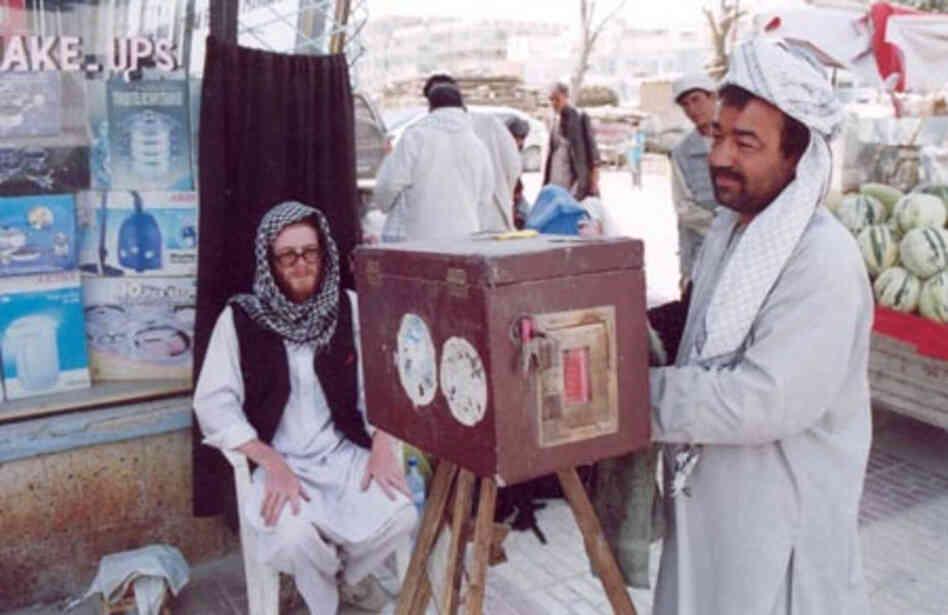 Lukas Birk's friend Sean has his photo taken by a street photographer in Mazar i Sharif in Northern Afghanistan.