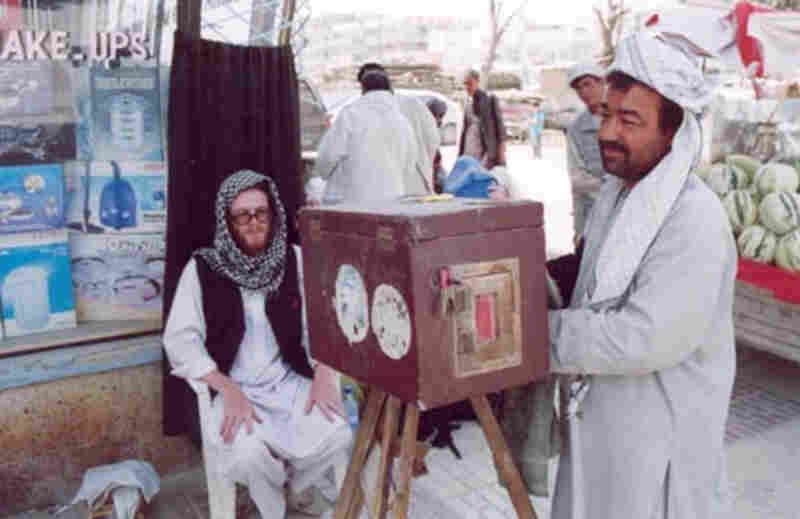 Lukas Birk's friend Sean has his photo taken by a street photographer in Mazar i Sharif in Northern Afghanistan.