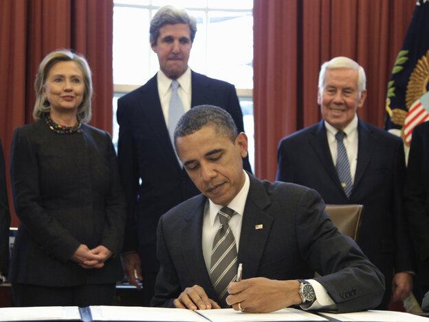 President Obama signs the New START Treaty, Wednesday, Feb. 2, 2011 as Secretary of State Hillary Rodham Clinton, Sen. John Kerry (D-MA) and Sen. Richard Lugar (R-IN) watch.