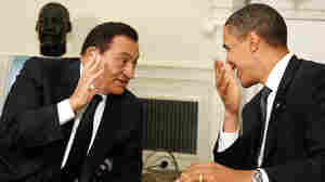President Obama and Egyptian President Hosni Mubarak, seen here in August 2009, have little to laugh about now. The protests and uncertainty in Egypt pose a foreign policy dilemma for Washington: stick with the Mubarak government or back the pro-democracy movement?