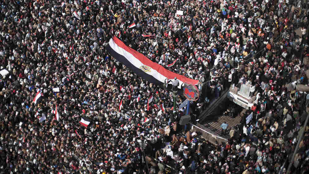 Anti-government supporters swarmed Cairo's Tahrir Square on Tuesday for the 15th consecutive day of opposition protests.