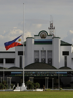 The Philippine national flag is displayed at half-mast Tuesday following the death of Gen. Angelo Reyes at the Armed Forces of the Philippines General Headquarters north of Manila. Reyes, accused of embezzling at least $1 million from the armed forces, died of a single gunshot wound in what witnesses described as an apparent suicide in front of his mother's grave.