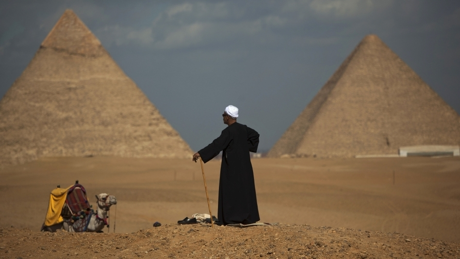 Egyptian camel driver Gamal, 54, waits for tourists near the pyramids,  in Giza, Egypt,  Jan. 31.