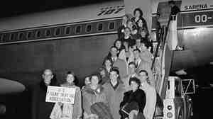Members of the U.S. Figure Skating Team pose at Idlewild International Airport in New York before boarding a Sabena jet to Brussels, Feb. 14, 1961, on their way to the World Championships in Prague. The plane crashed Feb. 15 near the airport at Brussels, killing all onboard.
