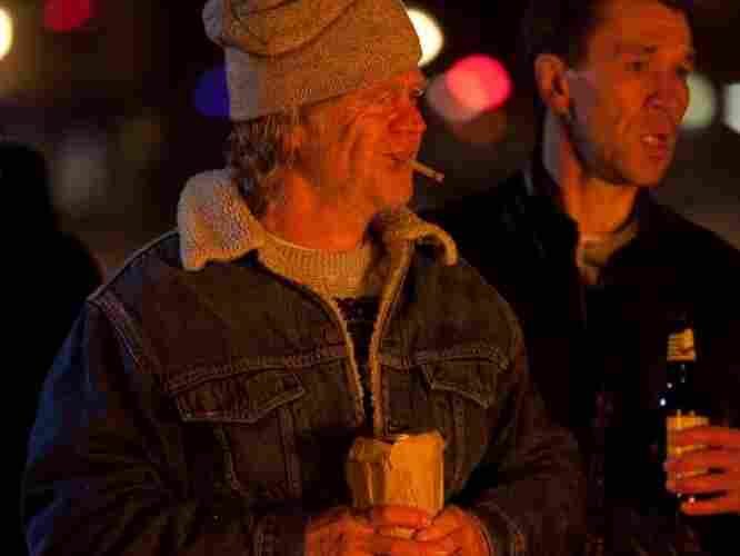 William H. Macy, as Frank Gallagher, stands at a bonfire with his family in Shameless.
