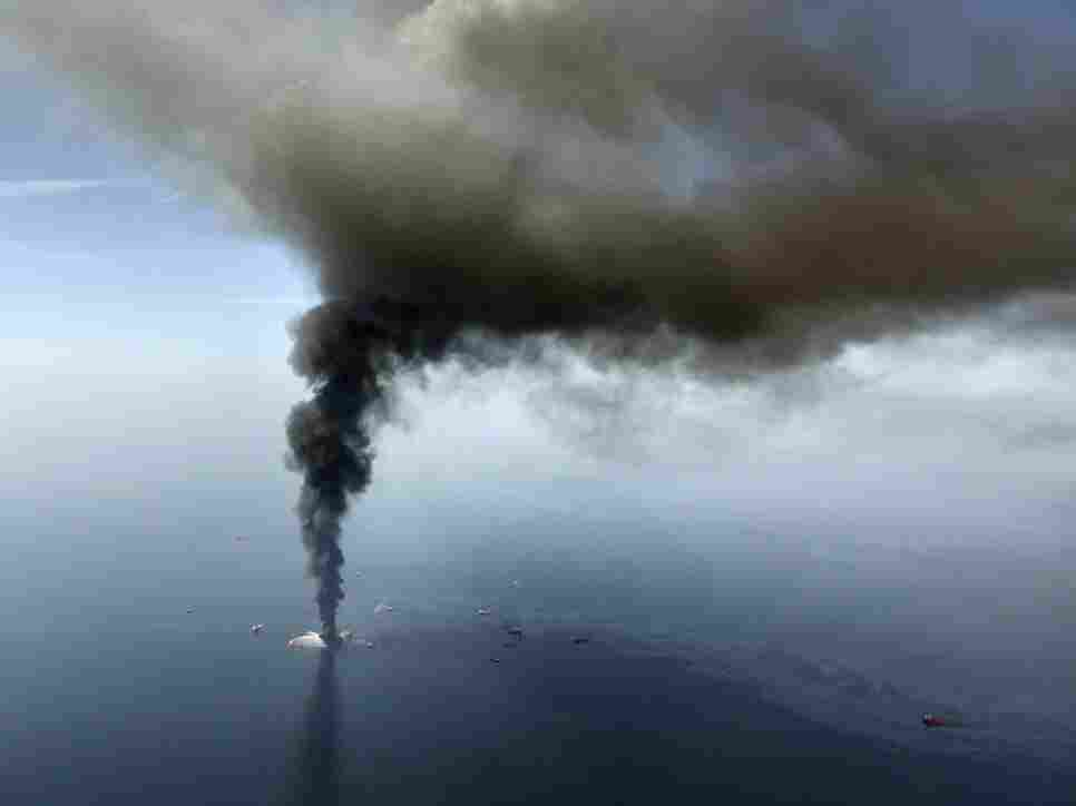 The Deepwater Horizon oil rig burns in the Gulf of Mexico.