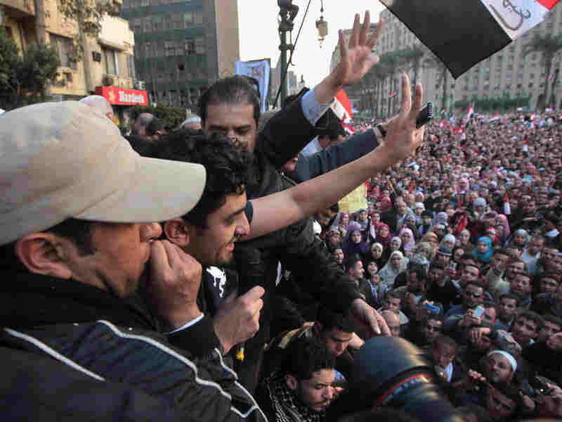 Google marketing executive Wael Ghonim (second from left) speaks to the thousands of protesters in Tahrir Square.