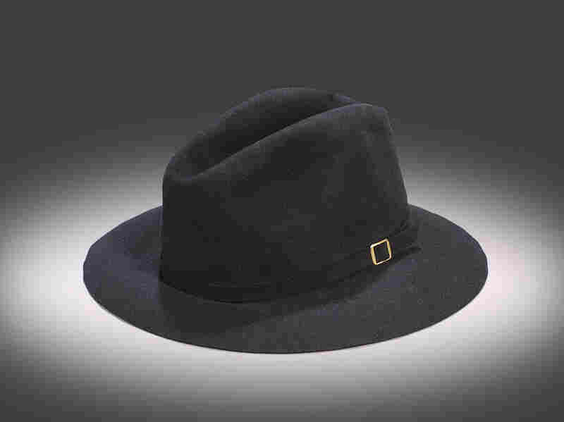 """Michael Jackson's Victory Tour Black FedoraInside the hat is a black leather band stamped """"By Maddest Hatter ... Made expressly for Michael Jackson ... 100 percent genuine fur."""" The hat was caught by an audience member attending the July 31, 1984, Jackson concert at Giants Stadium in East Rutherford, N.J."""