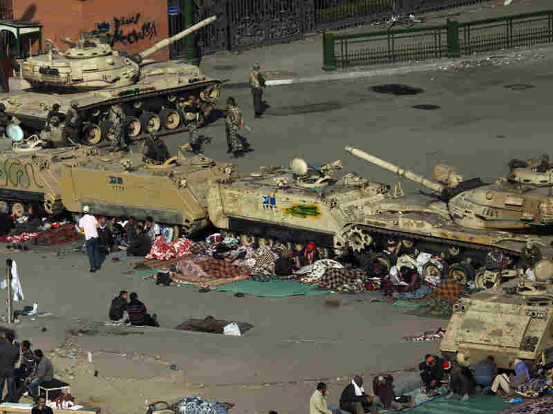 Anti-Mubarak protesters camped out next to army tanks and armored vehicles near Cairo's Tahrir Square on Wednesday.